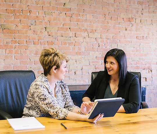 Two business women having a meeting with a tablet